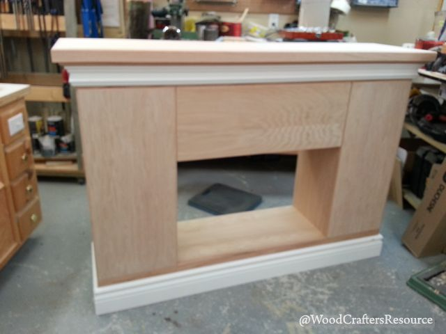 Faux fireplace hardwood edging added to all sides of the plywood doors